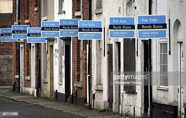 A row of for sale signs adorn the front of terraced houses on April 18 2008 in Macclesfield England The United Kingdom's financial outlook still...