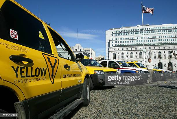A row of Ford Escape Hybrid taxicabs are seen February 22 2005 in San Francisco The city of San Francisco became the first city in the nation to use...