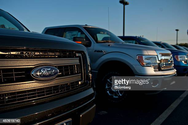 A row of Ford Motor Co 2014 F150 pickup trucks sit on the lot at Rod Baker Ford dealership in Plainfield Illinois US on Wednesday July 23 2014 Ford...
