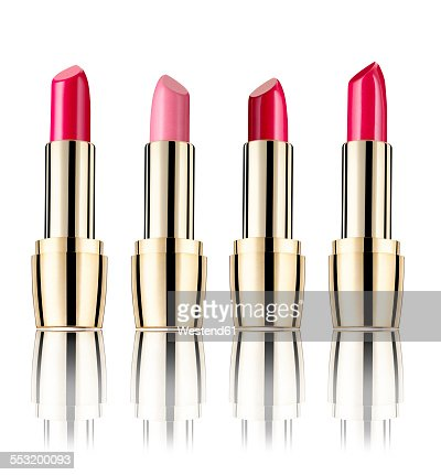 Row of four lipsticks in front of white background