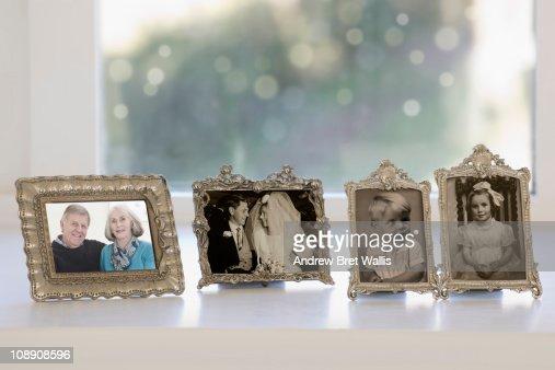 row of framed photos spanning a lifetime : Bildbanksbilder