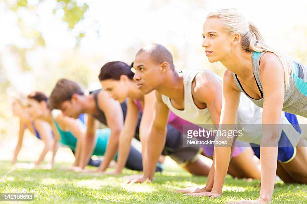 Row Of Friends Doing Push-Ups In Bootcamp