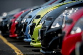 A row of General Motors Co 2014 Chevy Spark vehicles sit on the lot at Webb Chevrolet dealership in Plainfield Illinois US on Wednesday July 23 2014...