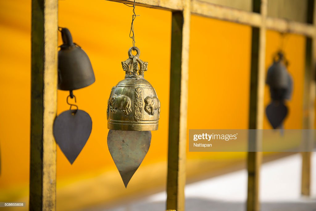 Row of golden bells in buddhist temple : Stock Photo