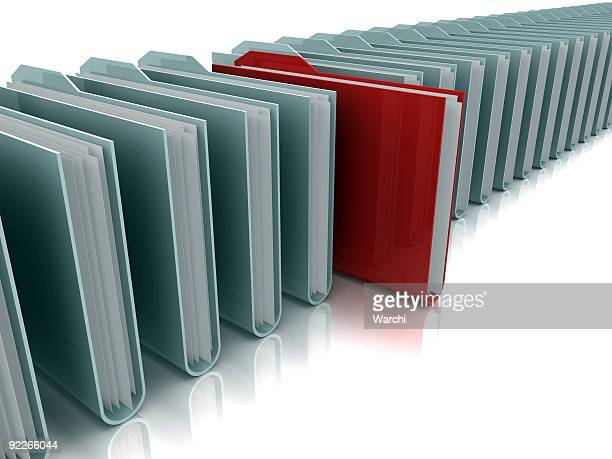 Row of gray folders with red folder standing out