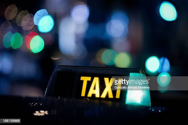 A row of green light signs on taxis as drivers wait for clients at Callao square on April 26 2013 in Madrid Spain According to taxi association Uso...