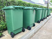 row of green plastic bin