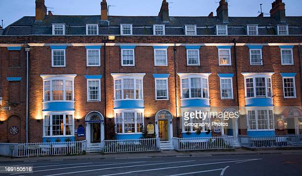 Row of guest houses and small hotels at night on the Esplanade Weymouth Dorset England