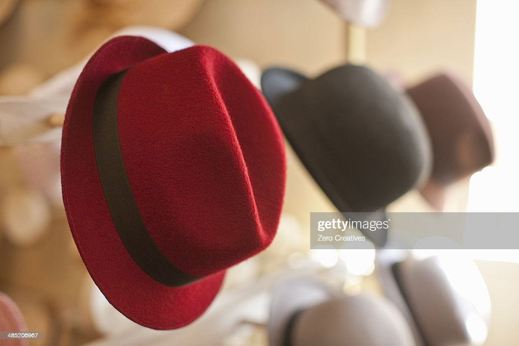 Row of hats in traditional milliners shop