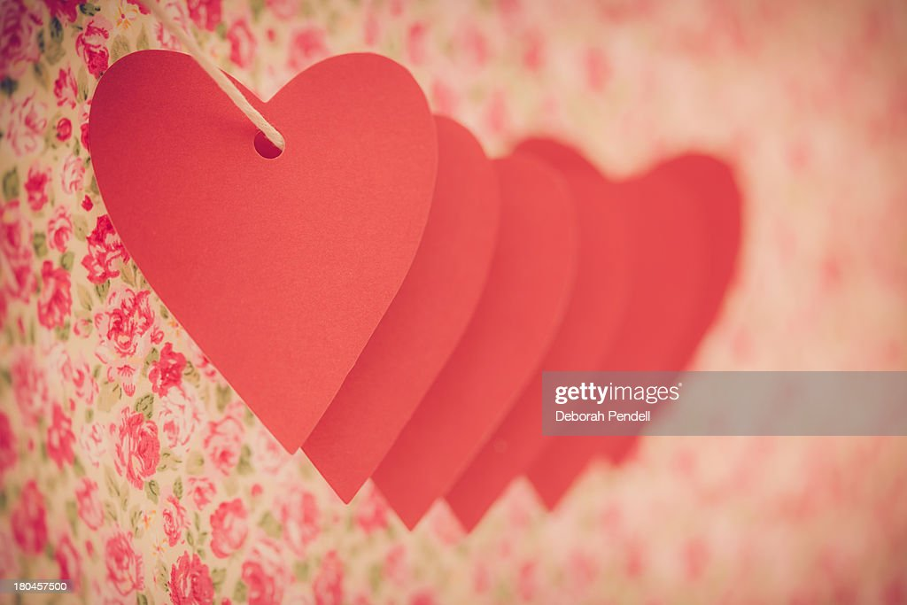 Row of hearts on vintage background : Stock Photo