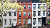 Row of historic buildings along 30th Street in Manhattan, New York City NYC