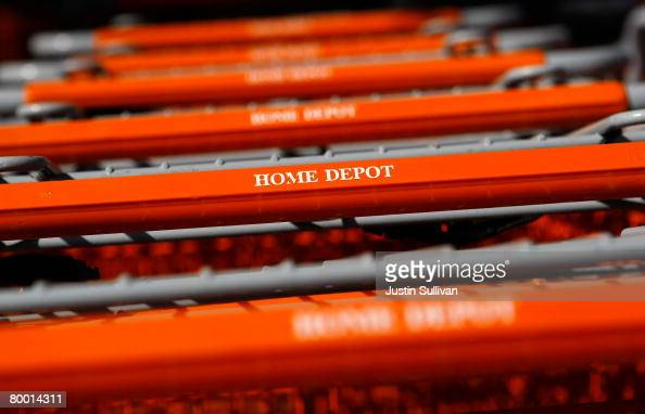 A row of Home Depot shopping carts are lined up outside of a Home Depot store February 26 2008 in Daly City California The Home Depot Inc reported a...