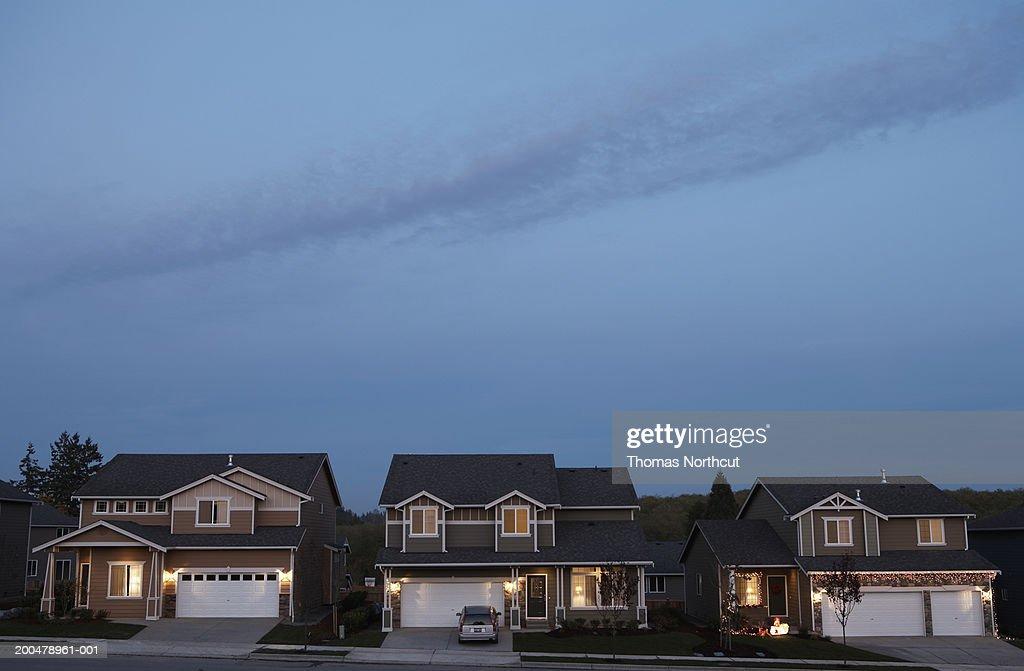 Row of houses illuminated at dusk : Stock Photo