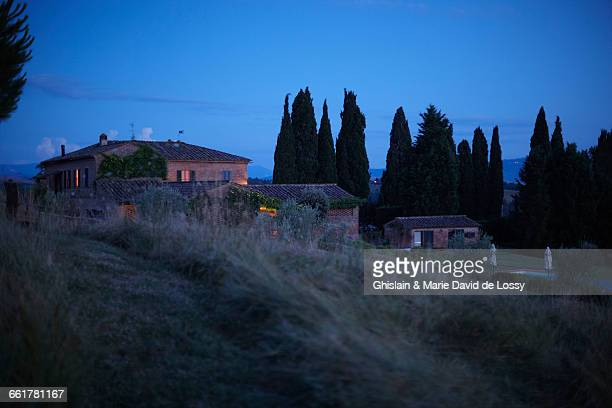 Row of houses on hillside, Buonconvento, Tuscany, Italy