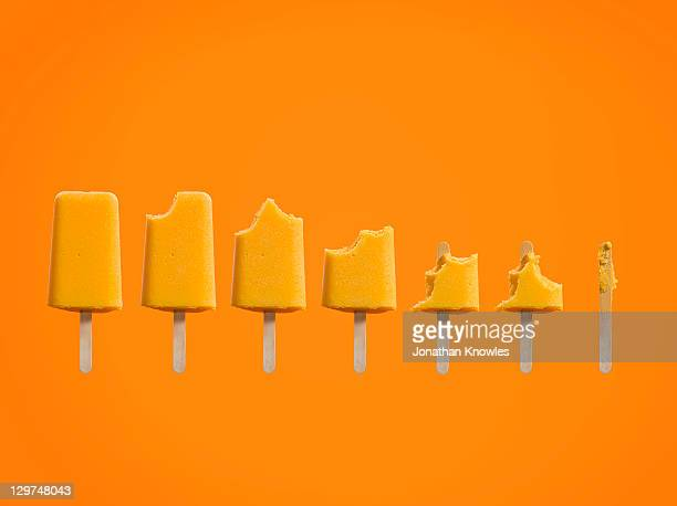 Row of ice cream lollies eaten at different stages