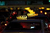 Row of illuminated taxis