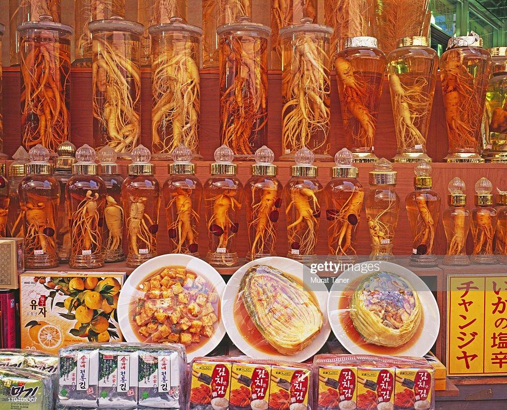 Row of jars at a market : Stock Photo