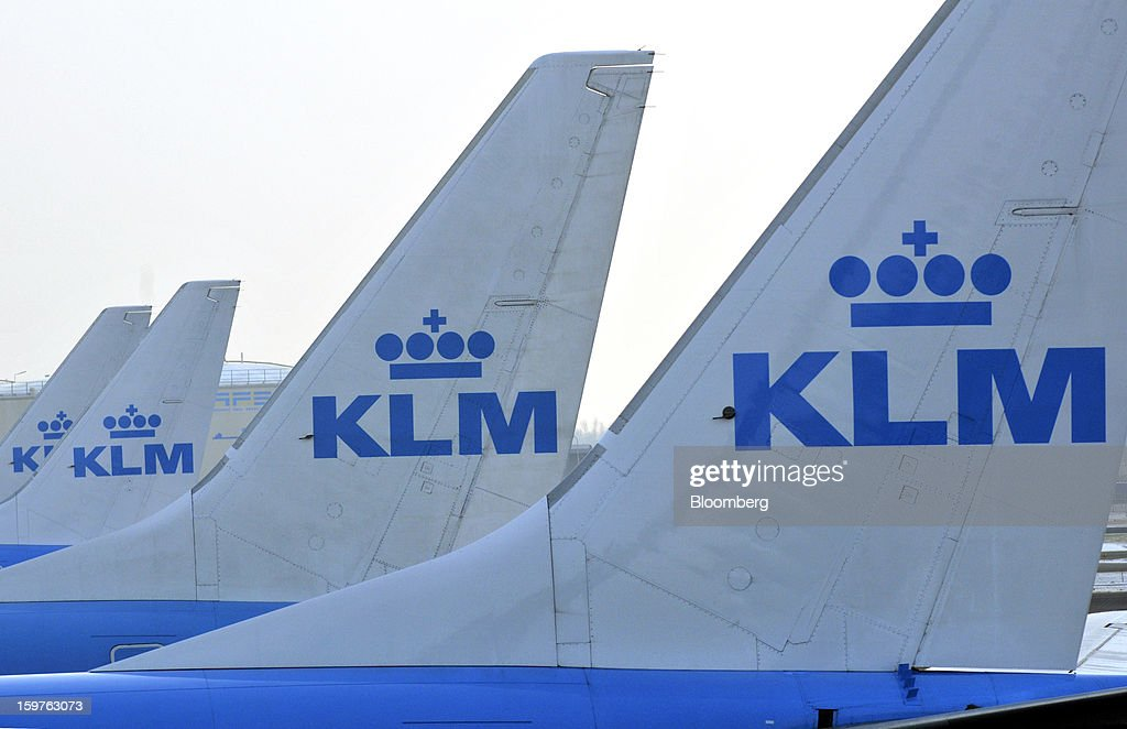 A row of KLM aircraft, operated by the Air France-KLM Group, Europe's biggest airline are seen on the tarmac at Schiphol airport in Amsterdam, Netherlands, on Friday, Jan. 18, 2013. Air France-KLM is seeking to repel incursions from discount operators led by Ryanair Holdings Plc and EasyJet Plc, which has added more flexible tickets to help lure business travelers. Photographer: Bryn Colton/Bloomberg via Getty Images