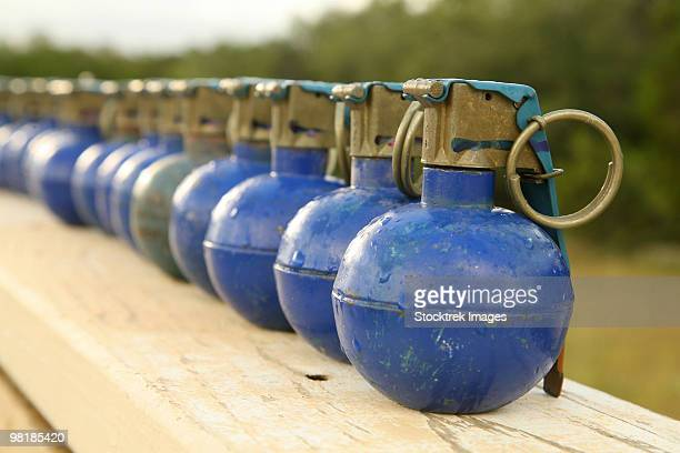A row of M-67 training grenades.