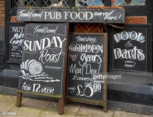 Row of menu boards outside a pub
