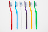 Row of multi-coloured toothbrushes