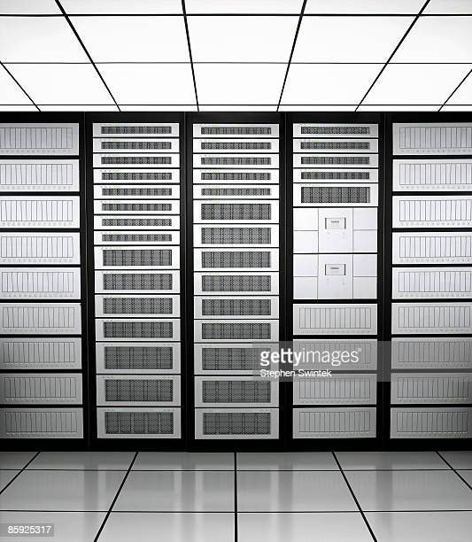Row of network servers in a server room