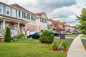 Stock photograph of a row of new homes and SOLD sign in Brantford Ontario Canada.