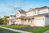 Stock photograph of a row of new homes and front yards in Brantford Ontario Canada.