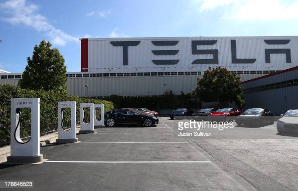 A row of new Tesla Superchargers are seen outside of the Tesla Factory on August 16 2013 in Fremont California Tesla Motors opened a new Supercharger...
