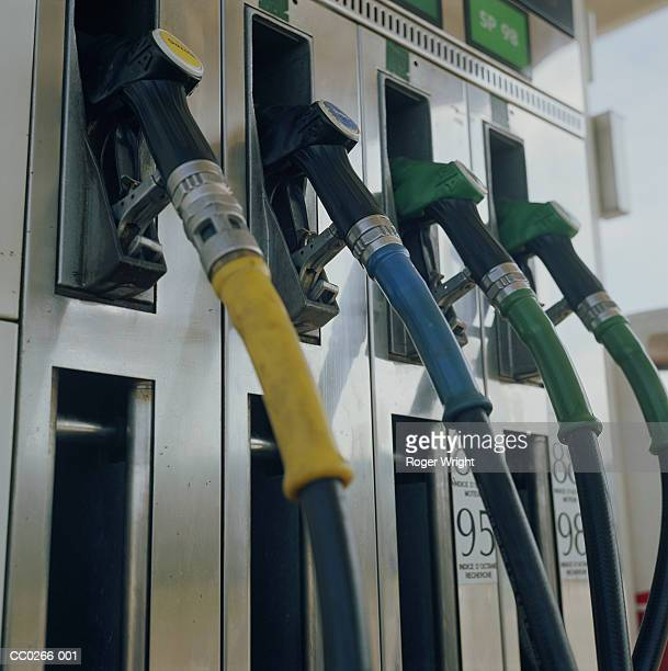 Row of nozzles at petrol station, close-up