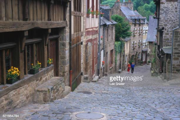 Row of Old Houses on Cobblestone Road
