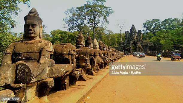 Row Of Old Statues By Road