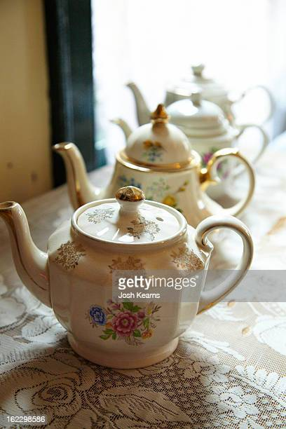 A row of old teapots