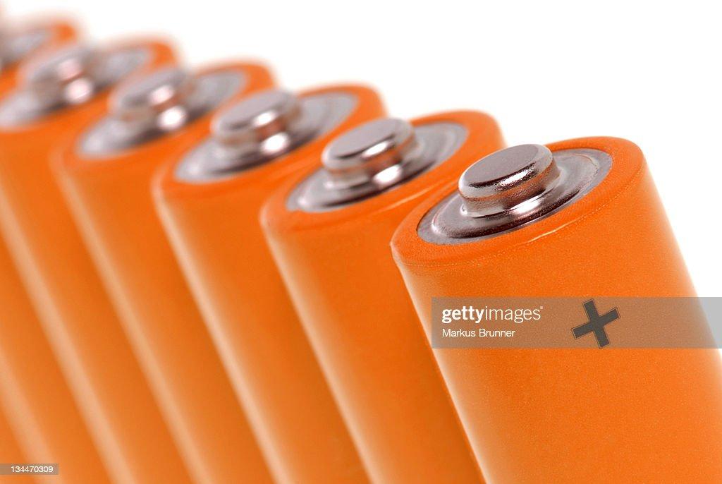 Row of orange batteries