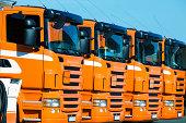 Row of orange trucks