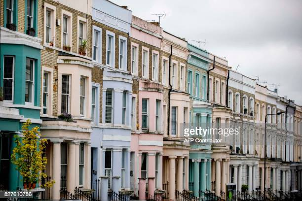 A row of painted houses is pictured on Westbourne Park Road near Portobello Road Market in the Notting Hill district of west London on August 8 2017...