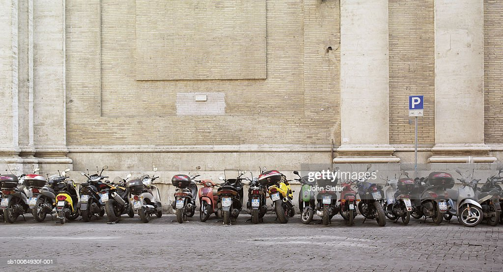Row of parked motorbikes : Stock Photo