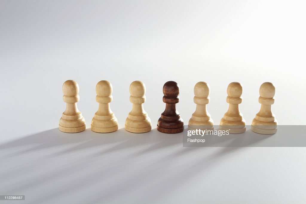 Row of pawn chess pieces : Stock Photo