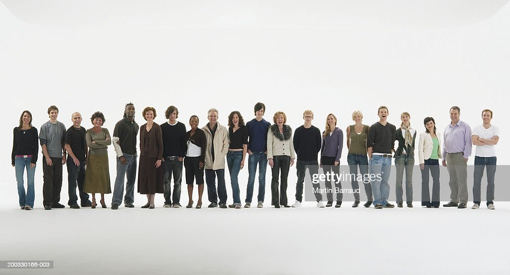 Row of people standing in line, smiling, portrait : Stock Photo