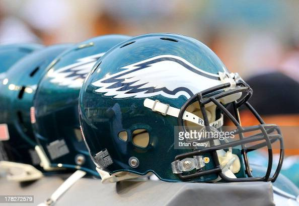 A row of Philadelphia Eagles helmets rest on the sidelines before a game against the Jacksonville Jaguars at EverBank Field on August 24 2013 in...
