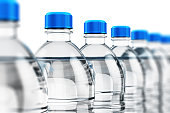 3D render illustration of the row of plastic bottles with clear purified drink carbonated water isolated on white background with selective focus effect