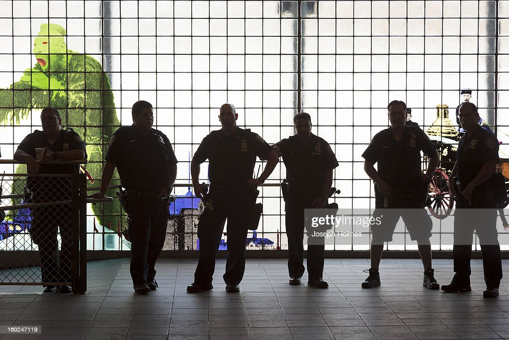 CONTENT] A row of police officers keeps an eye on the summer crowd going in and out of Coney Island Station in Brooklyn, NY.