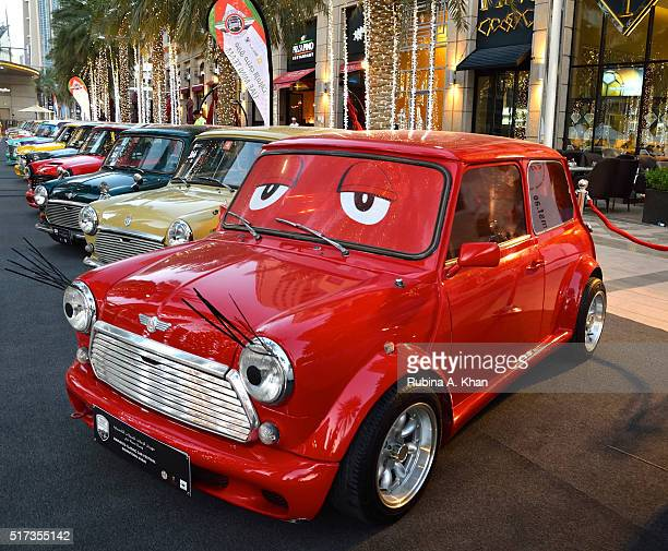A row of pop coloured Mini Coopers at the 8th Emirates Classic Car Festival 2016 that has over 300 vintage vehicles from 1916 to 1986 on display at...