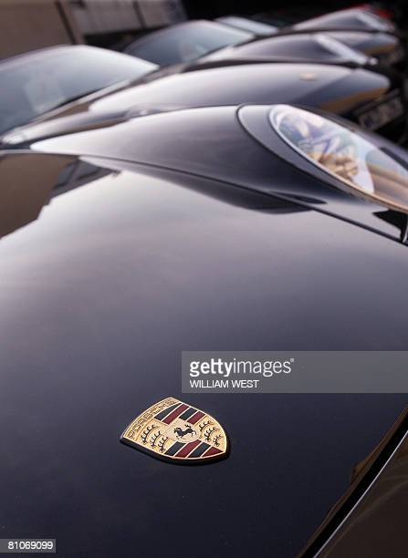 A row of Porsche cars line up at a Melbourne dealership as Treasurer Wayne Swan confirms that his budget will include a provision to lift the tax on...