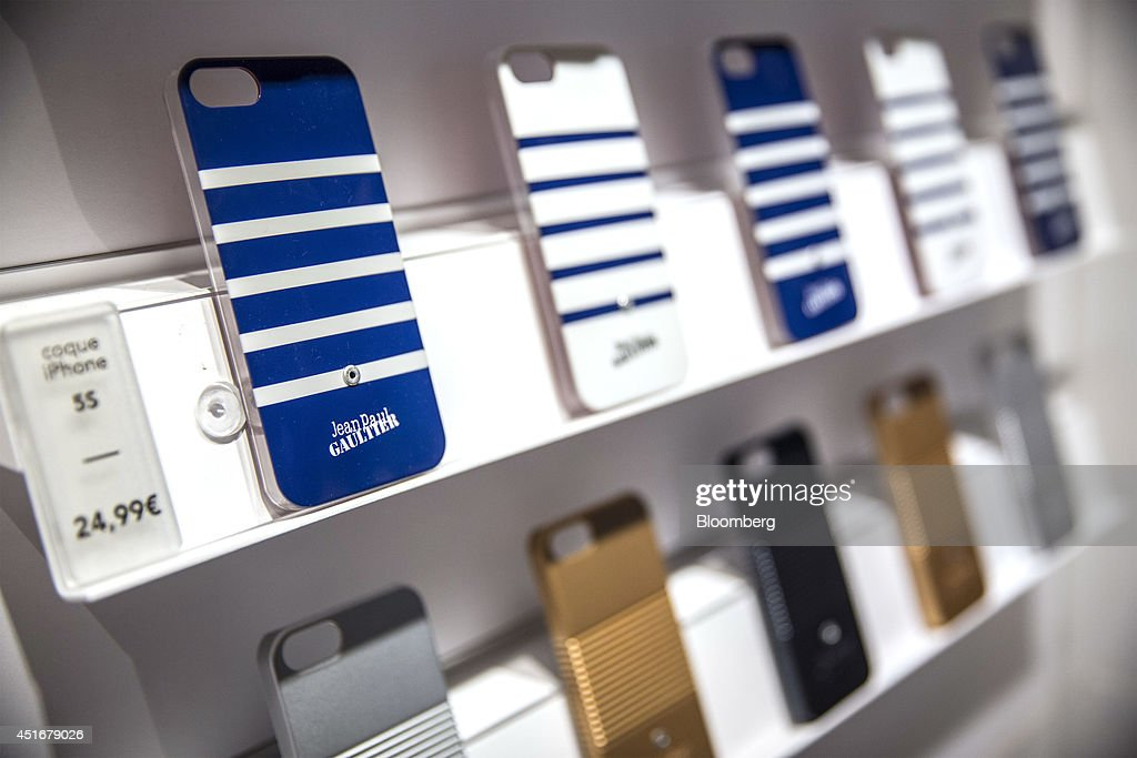 A row of protective cases for the Apple Inc. iPhone 5s sit on a shelf and are displayed for sale inside a Bouygues Telecom store, operated by Bouygues SA in Paris, France, on Thursday, July 3, 2014. Bouygues Telecom, France's third-largest mobile operator, was looking for a buyer as profitability and cash generation declined. Photographer: Balint Porneczi/Bloomberg via Getty Images
