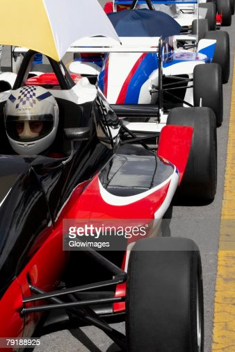 Row of racecars on a motor racing track : Foto de stock