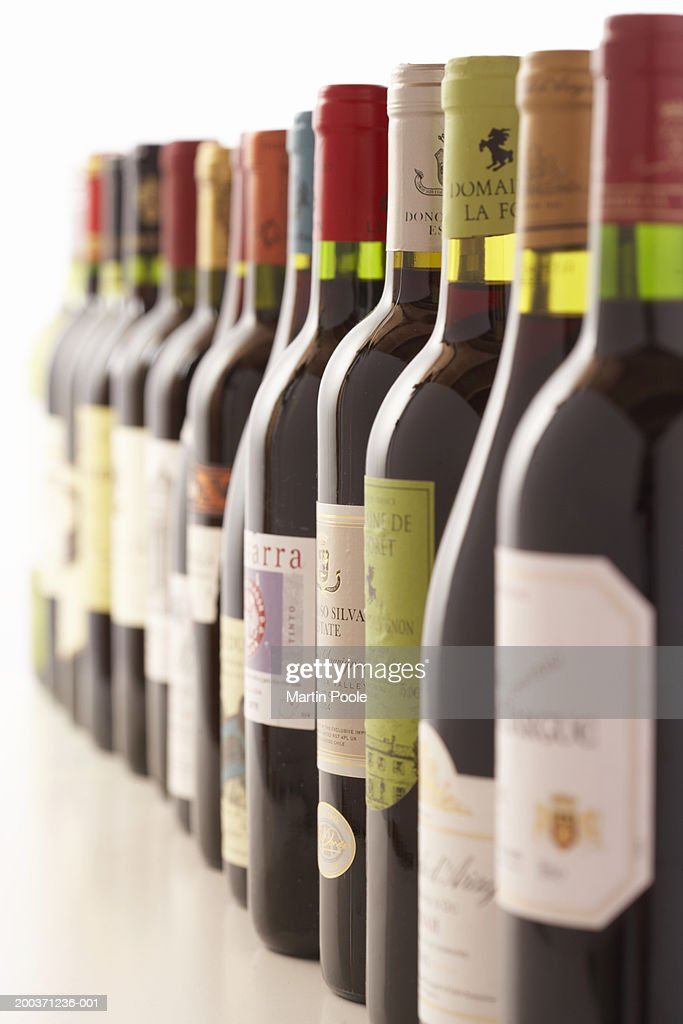 Row of red wine bottles