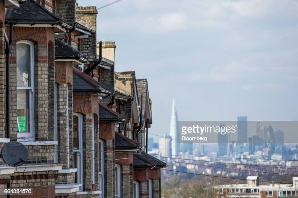 A row of residential properties stand in front of the City of London financial district in London UK on Monday April 3 2017 UK house prices fell for...