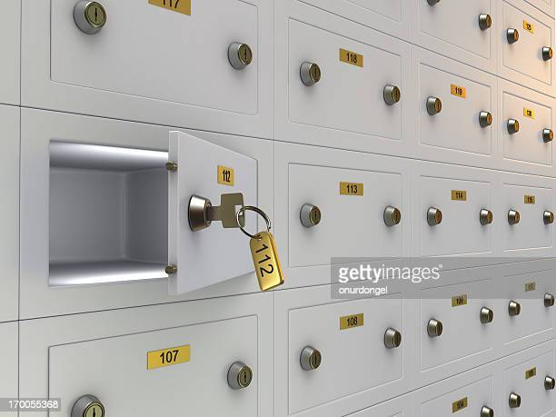 A row of safety deposit boxes with one opened