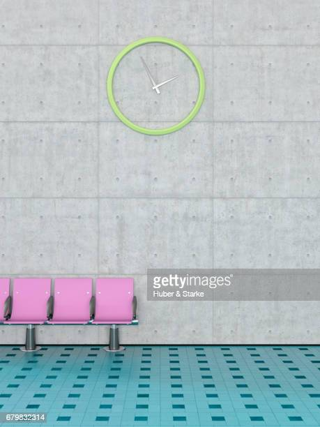 row of seats in front of concrete wall